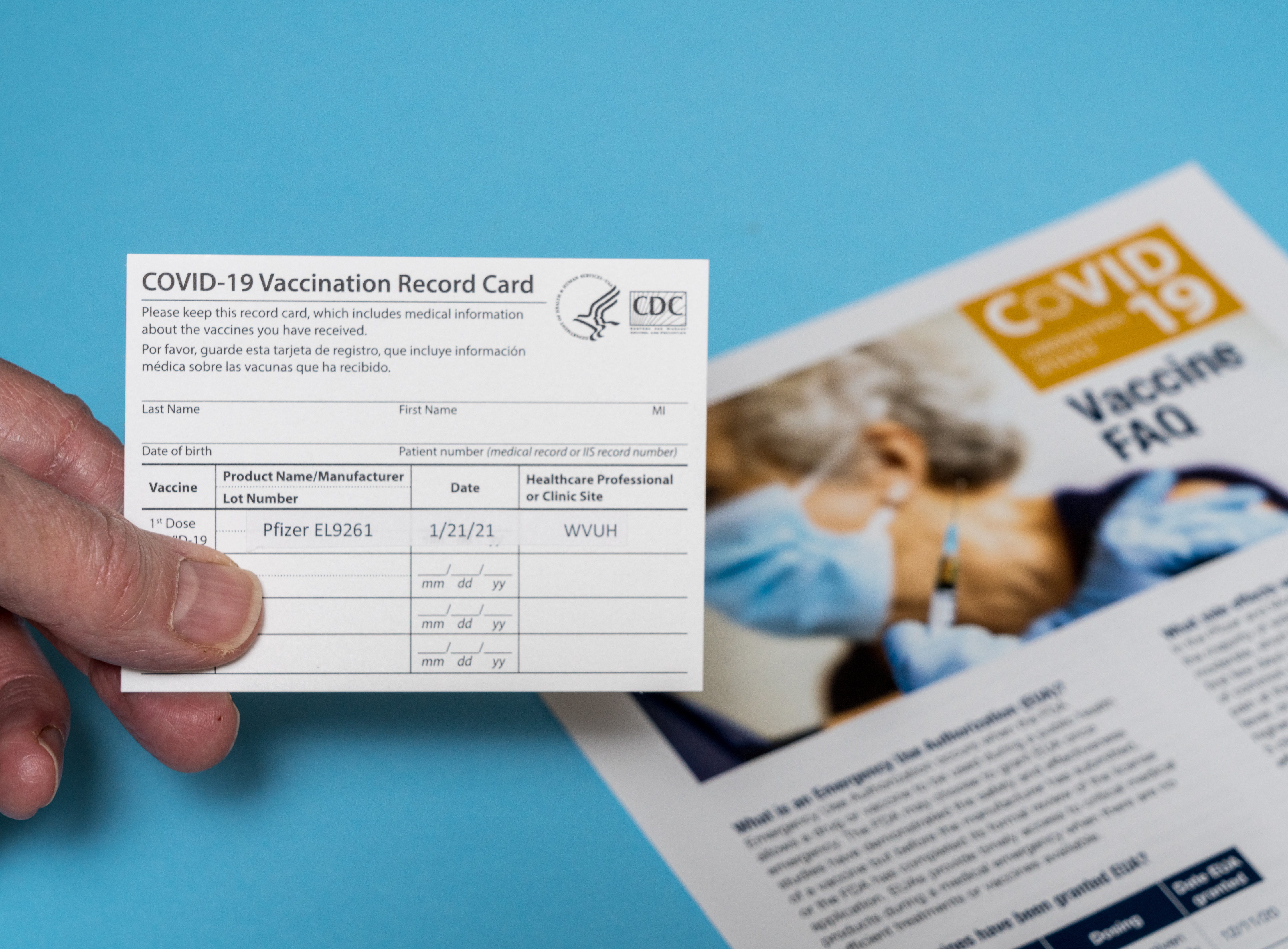 Covid-19 Vaccination Record Card showing first dose of Pfizer vaccine